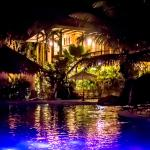 View of the rooms from the pool by night