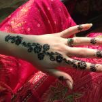 Mina, a Dommat waiter's wife, does amazing Henna