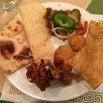 Plate of food with pakora, naan etc