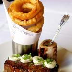 30 Day Aged 16 oz Prime NY Strip with Bone Marrow and Crispy Onion Rings (photo by Graham Blacka