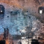 Nighttime view of a portion of the Roman Wall behind City Grange Hotel