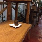 Wooden tables inside Cafe Atrapasuenos