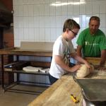 Kneading bread with the village baker