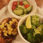 Baked chicken with bbq sauce and apples,  steamed broccoli and tomato /cucumber salad