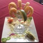 Shrimp Cocktail - With a Sweet & Spicy Jalapeño Sauce. Served with Guacamole & Pico de Gallo.