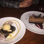 Two delicious chocolate desserts. One brownie with Guiness ice cream and a peanut butter pie.