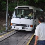 Yute Expeditions bus crossing Xunantunich hand crank ferry