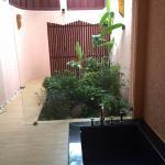 Bath and outdoor shower in villa