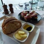The legendary warm sour dough bread served with prosciutto, fig chutney and topped with bocconci