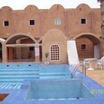 vue piscine et chambres