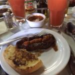 Steak, garlic bread and papaya smoothie