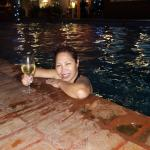 Enjoying the pool with a glass of wine from the bar
