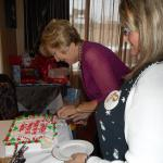 cutting a birthday cake in a lovely room for guests