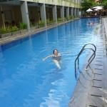 Pool with rooms beside and pool bar at the end.  Has kiddie pool and playground other side of ba