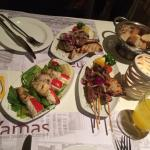Lamb chops, souvlaki, squid with cheese and the pita bread