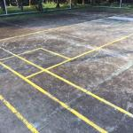 The tennis/volleyball court is very dilapidated.