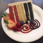 The Texas Cake...Strawberry, White Chocolate, Blueberry layers in Italian Cream Icing!