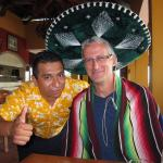 Edgar at the Mexican restaurant, try the hot sauce!