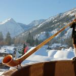 Mr. Johnson plays the Alphorn at breakfast