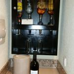 nice little bar in room with fridge