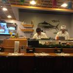 chefs busy making sushi