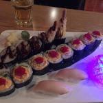 tuna on rice, shrimp tempura roll and parrot roll
