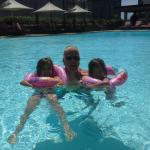 My twin girls and me in the pool.