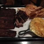 Half slab of ribs dinner with two sides of kettle chips and mac and cheese with an added side of