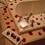 rose petals and chocolates put in room while they were out