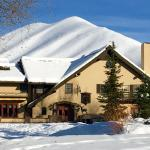The Sun Valley Inn in the snow on a sunny day