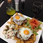 chivito/steak burger on a plate