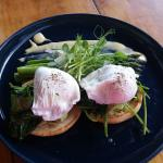 Big green breakfast - spinach, avocado, asparagus, poached eggs, english muffin with hollandaise