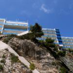 the Bellevue hotel seen from their beach below