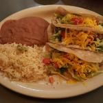 Three soft beef taco meal with beans and rice