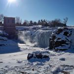 Frozen falls with steam
