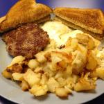 breakfast of eggs, homefries, hand-shaped sausage patty and toast
