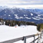 Spectacular views !  And a ski slope too with skiers...
