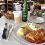 Pollo with yuca and local brew