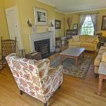 The front parlor is a perfect place to relax by the fire in the winter, on wedding weekends it o