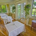 The added breakfast porch is a bright and beautiful place to enjoyr a tasty breakfast
