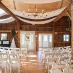 A bride and groom chose to hold their ceremony in our event barn. Later the chairs were removed