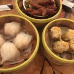Scallop dumplings with truffle bits, steamed ribs, BBQ pork bun, shrimp dumplings, chicken feet,