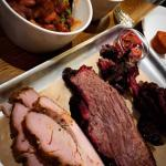 Smoked turkey, brisket, and pork cheeks, with sides of beans and mac and cheese