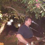 Duane Carleton playing on the patio