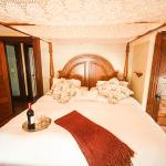 This room features king sized bed with a romantic canopy. Personal refrigerator.  Ava Jolee's is