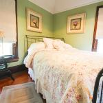 This room features a queen sized bed elegantly appointed decor. Enjoy personal refrigerator and
