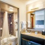 Suite Bathroom with granite counter and tub