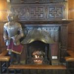 It is a real suit of armor and fireplace from Europe