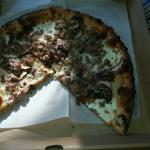 Terrible burned dried up pizza