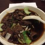 Counter at walk up ordering and braised beef noodle soup